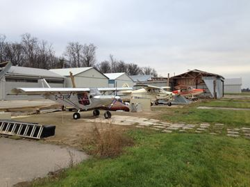 These aircraft were inside hangars that blew away.