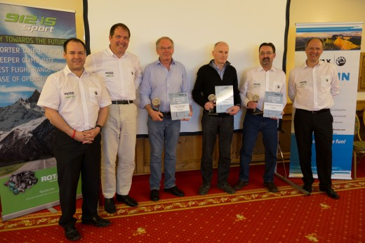 Mark Paskevich, second from right, accepts award on behalf of Rotech Research.