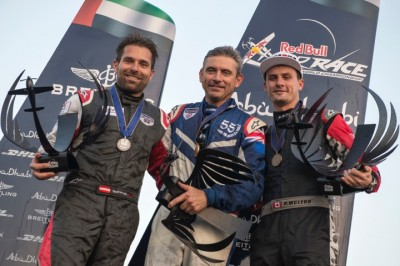 Canadian Red Bull Race pilot Pete McLeod, right, came third in the first race of the season behind Hannes Arch, left, and Paul Bonhomme. Photo by Naim Chidiac