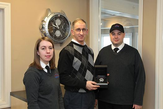 From left, Instructor Madeline Koby, winner Gaetan Boudreau and Brampton Flight Centre 's Rob Carney.