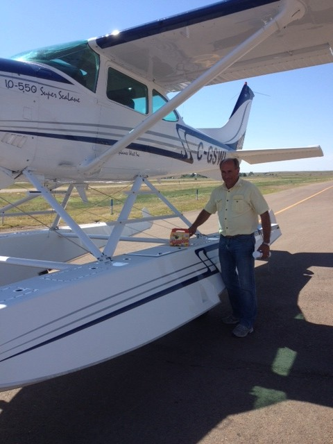 On our way...Making a Fuel Stop in  Wolf Point, Montana.  Jim Schwerman of Seaplanes West is giving us a ride.