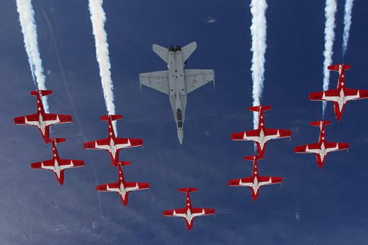 The CF-18 tucks into the slot with the Snowbirds during Spring Training in Comox.