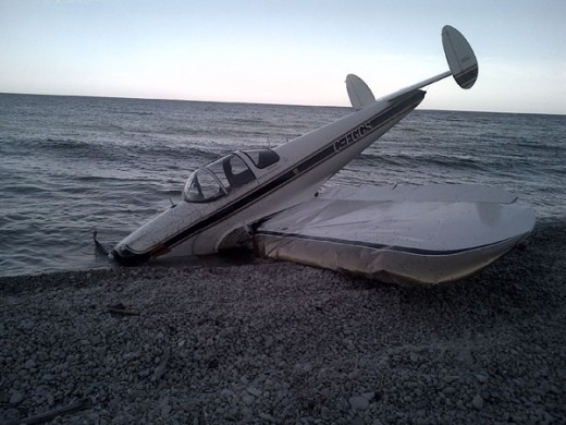 A Canadian Ercoupe was damaged in a beach landing on a Lake Michigan Island.