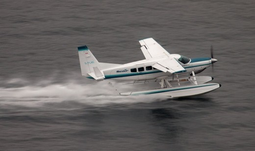 A Seair Caravan pilot reported coming within 10 feet of a UAS.