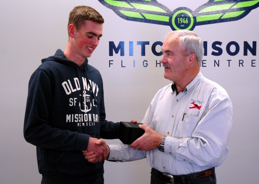 Josh Kerr accepts Hamilton watch from Malcolm McLeod.