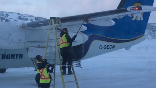 A passenger submitted this  photo of manual deicing to the CBC.