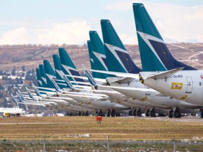 WestJet Blames COVID Policy For Cuts