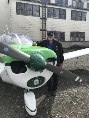 Steve and his Cherokee outside historic Watson Lake hangar